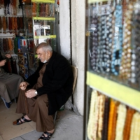 An man sells rosaries at a shop in Fallujah last Wednesday.  | REUTERS