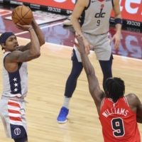 Wizards guard Bradley Beal shoots against Bulls forward Patrick Williams on Monday in Chicago. | USA TODAY / VIA REUTERS