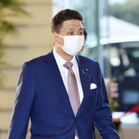 Defense Minister Nobuo Kishi arrives at the Prime Minister's Office for a Cabinet meeting on Tuesday. | KYODO