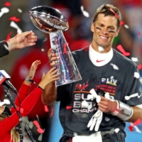 Buccaneers quarterback Tom Brady celebrates with the Vince Lombardi Trophy after winning Super Bowl LV on Sunday in Tampa, Florida. | USA TODAY / VIA REUTERS