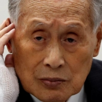 Despite condemnation over sexist remarks, 83-year-old Tokyo Olympics chief Yoshiro Mori remains insulated within the organization he leads, sources say, with officials fearing that his resignation would imperil the games. | REUTERS