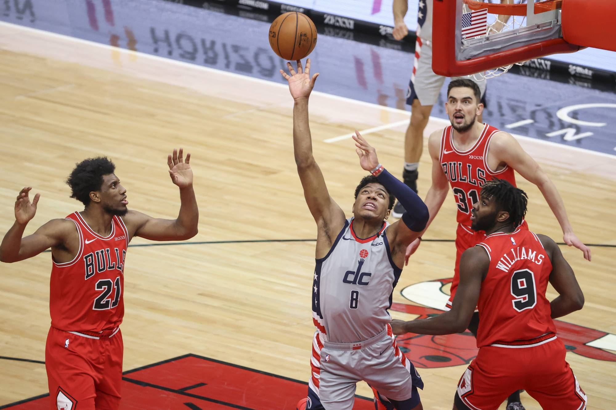 Washington Wizards forward Rui Hachimura shoots against Chicago Bulls forward Patrick Williams during the second half at United Center in Chicago on Monday. | KAMIL KRZACZYNSKI / USA TODAY VIA REUTERS