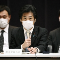 Health minister Norihisa Tamura speaks during a meeting of the government's subcommittee on the COVID-19 pandemic in Tokyo on Tuesday. | KYODO