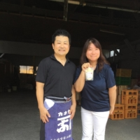 144-year 'newcomers': Yoko Nagatomo Shiomi (right) with her husband, Yuichiro Shiomi, hold up a packet of their brewery's amazake (sweet, low-alcohol sake). | JOAN BAILEY