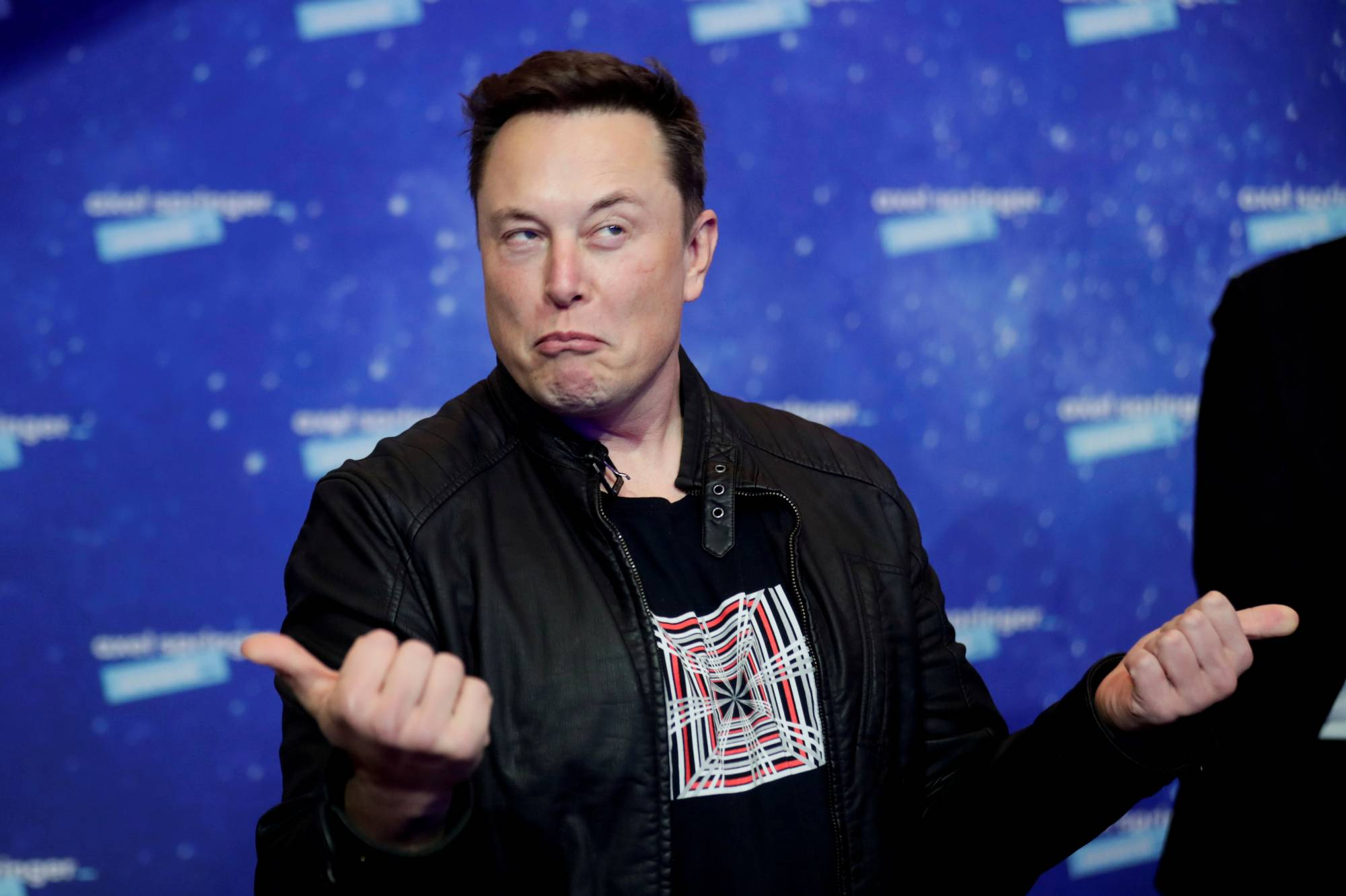 Clubhouse, where Tesla CEO Elon Musk has made appearances, is a year-old social media service consisting of virtual 'rooms' where people can talk to each other. | POOL / VIA REUTERS