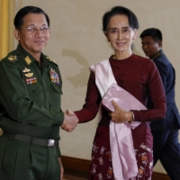 Senior Gen. Min Aung Hlaing, Myanmar's commander-in-chief, and National League for Democracy leader Aung San Suu Kyi in 2015 | REUTERS