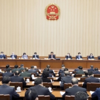 China's Standing Committee of the National People's Congress, its top legislative body, passed the coast guard bill on Jan. 22 in Beijing. | XINHUA NEWS AGENCY / VIA KYODO