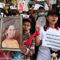 People rally against the Myanmar military's coup and demand the release of elected leader Aung San Suu Kyi, in Yangon, Myanmar, on Tuesday.  | REUTERS