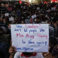 Protesters in Myanmar have found themselves being picked up on social media in recent days thanks to their creative, blunt and often darkly humorous signs. | AFP-JIJI