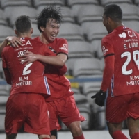 Gil Vicente midfielder Kanya Fujimoto (center) celebrates with teammates after scoring against Sporting on Tuesday in Barcelos, Portugal. | AFP-JIJI