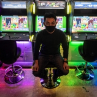 Yasushi Fukamachi, a manager at the Mikado game center in Tokyo's Shinjuku neighborhood, says customers were slow to return after Japan's first state of emergency last year. | AFP-JIJI