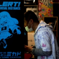 The Mikado arcade has turned to streaming video-game matches on YouTube to reach gamers stuck at home and earn advertising money. | AFP-JIJI
