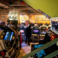 Bright, noisy game centers are still a neighborhood fixture in Japan, but have been disappearing as business is hit by virus-curtailed opening hours. | AFP-JIJI