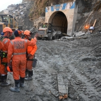 National Disaster Response Force personnel prepare for a rescue operation outside the entrance of a tunnel in the Chamoli district of India on Wednesday.  | AFP-JIJI