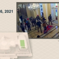 A still photo from U.S. Capitol security footage shows supporters of U.S. President Donald Trump, including one carrying a Confederate battle flag, enter the Capitol on Jan. 6.  | U.S. SENATE / VIA REUTERS