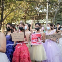 Women wearing ball gowns protest against the military coup and demand the release of elected leader Aung San Suu Kyi in Yangon on Wednesday. | KYAW SOE THET / VIA REUTERS