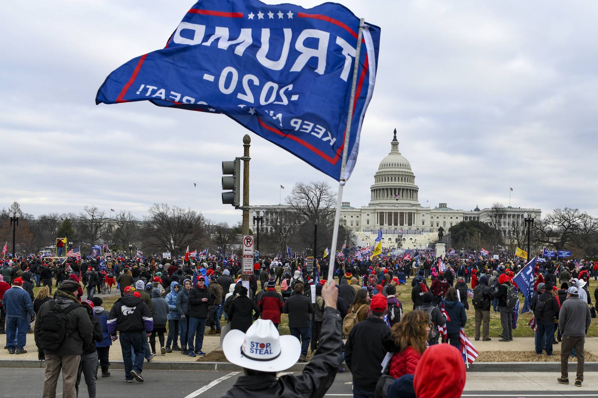 Supporters of U.S. President Donald Trump march to the Capitol in Washington after hearing him speak at a rally outside the White House on Jan. 6.  | KENNY HOLSTON / THE NEW YORK TIMES