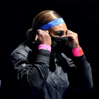 Serena Williams adjusts her face masks ahead of her third-round match against Russia's Anastasia Potapova during Day 5 of the Australian Open in Melbourne on Friday. | AFP-JIJI