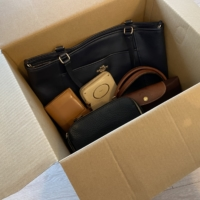 Brand-name bags and wallets packed in cardboard boxes waiting to be collected | SEINO TRANSPORTATION