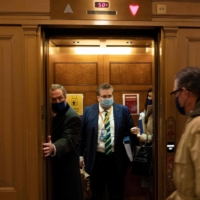 Defense lawyers Michael van der Veen and Bruce Castor Jr. (right) leave after the fourth day of former U.S. President Donald Trump's impeachment trial before the Senate on Capitol Hill in Washington on Friday. | AFP-JIJI
