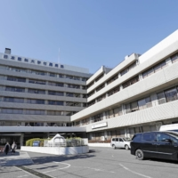 A hospital in Tokyo's Bunkyo Ward. A total of 132 people with the coronavirus died in places other than hospitals in January. | KYODO