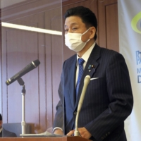 Defense Minister Nobuo Kishi speaks during a news conference at the Defense Ministry in Tokyo on Friday. | KYODO