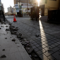 A collapse building wall in Iwaki, Fukushima Prefecture, on Sunday morning |  REUTERS