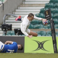 England's Jonny May scores his team's third try against Italy in Six Nations action on Saturday in London. | REUTERS