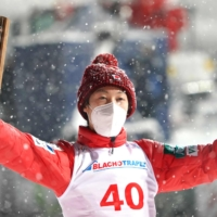 Ryoyu Kobayashi poses on the podium after winning a ski jumping World Cup competition on Saturday in Zakopane, Poland. | AFP-JIJI