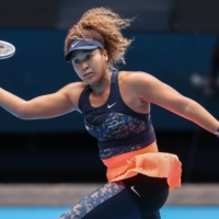 Naomi Osaka fights back from the brink to reach quarterfinals