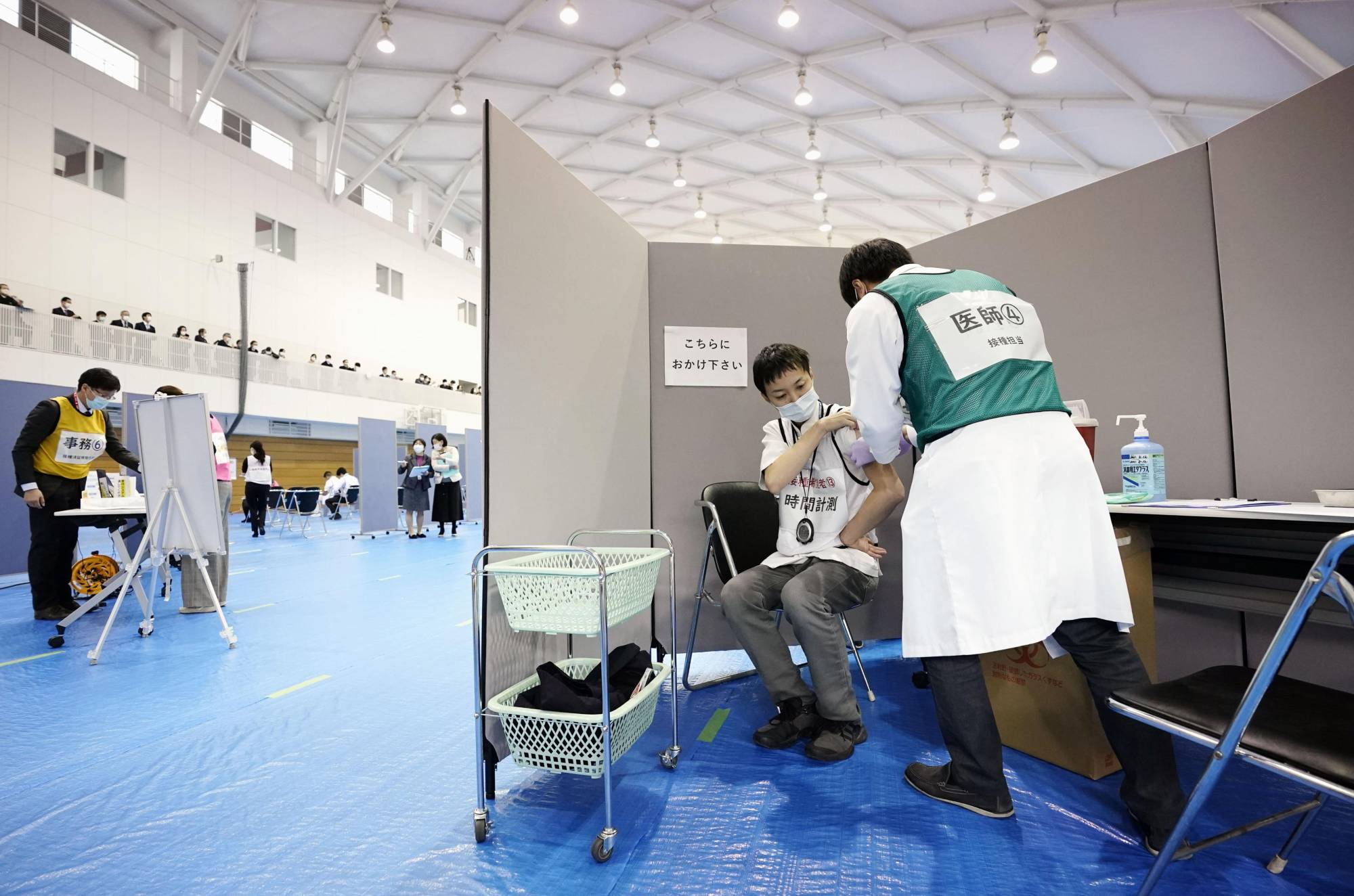 A vaccination drill for novel coronavirus is conducted at Fujita Health University in Aichi Prefecture on Friday. | KYODO
