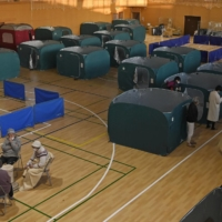 People spent the night at an evacuation center set up at a gymnasium in Soma, Fukushima Prefecture, following Saturday's strong quake. | KYODO