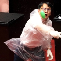 Lawmakers from Taiwan's Democratic Progressive Party and the Kuomintang throw water balloons at each other inside the parliament in Taipei last July. | REUTERS