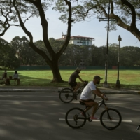 Bikers ride near the University of The Philippines in Quezon City on Jan. 29.  | JES AZNAR / THE NEW YORK TIMES