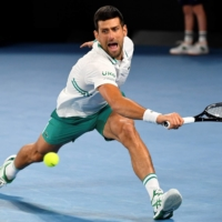 Injured Novak Djokovic accepts risks of playing through pain at Australian Open