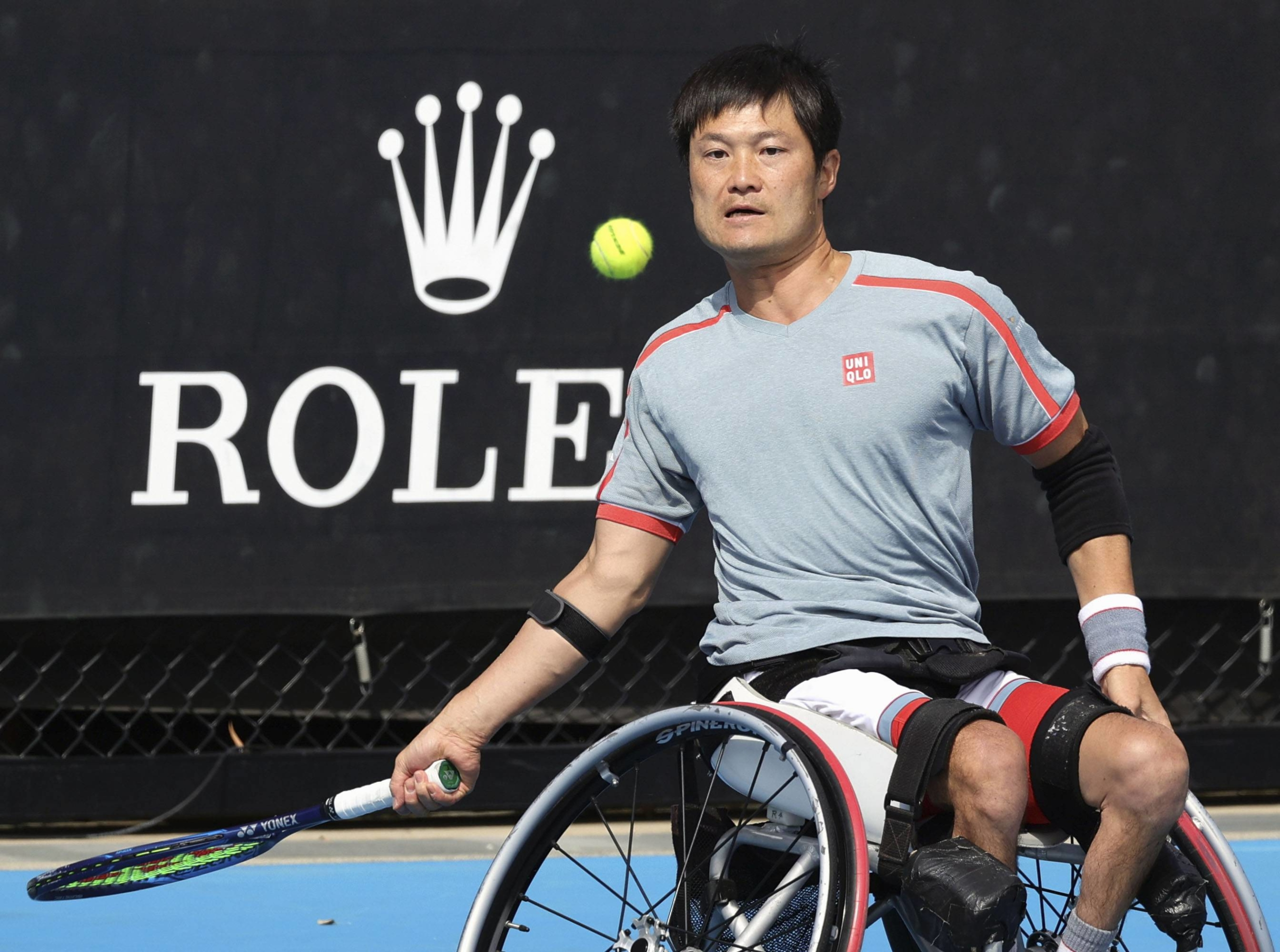 Shingo Kunieda hits a shot against Alfie Hewitt during the Australian Open semifinals in Melbourne on Monday. | KYODO