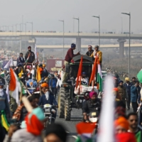 A tractor rally in support of protests in New Delhi on Jan. 26 turned violent when farmers and their supporters clashed with police and stormed city landmarks.  | BLOOMBERG