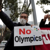 Protesters call for the Tokyo Olympic and Paralympic Games to be cancelled, during a rally Friday in front of the offices of the Tokyo Organising Committee of the Olympic and Paralympic Games. | REUTERS