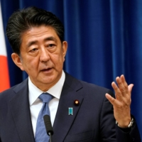 Shinzo Abe  | POOL / VIA REUTERS
