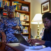Nigeria's Ngozi Okonjo-Iweala is helped by her son, Okechukwu Iweala, as she works on her acceptance speech on Monday at her home in Potomac, Maryland, minutes before she was confirmed as the first woman and first African leader of the World Trade Organization. | AFP-JIJI
