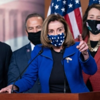 U.S. Speaker of the House Nancy Pelosi, alongside House impeachment managers, speaks to the media in Washington on Saturday after the Senate voted to acquit former U.S. President Donald Trump.  | AFP-JIJI