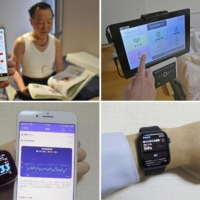 Clockwise from top left: A man wearing Mitsufuji Corp.'s shirt that monitors heart rates; Paramount Bed Co.'s 'smart bed system,' with a patient lying in a bed that measures respiratory and heart functions; Apple Inc.'s Apple Watch; and Fitbit Inc.'s smartwatch. | KYODO