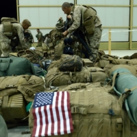 U.S. Marines in Kandahar check their equipment after withdrawing from the Camp Bastion-Leatherneck complex in Helmand province, Afghanistan, in October 2014. | AFP-JIJI
