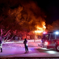 Residents of Cedar Crest Drive walk past their burning house as firefighters, who were only able to draw water from one hydrant because all three city water treatment plants were offline due to cold weather power outages, try to contain the fire in Abilene, Texas,   RONALD W. ERDRICH/REPORTER-NEWS/USA TODAY NETWORK VIA REUTERS.
