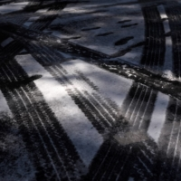 Tire tracks and footsteps are seen in the snow on Tuesday as the state of Texas experiences widespread power outages and record-breaking temperatures in Houston    REUTERS