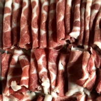 Game time: Thin slices of fat-marbled boar meat laid out in preparation for shishinabe (boar hot pot). | HANNAH KIRSHNER
