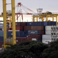 Containers at a shipping terminal in Yokohama in December. Japan's exports rose 6.4% from a year earlier in January driven by brisk demand in China. | BLOOMBERG