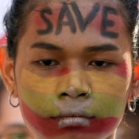 A demonstrator takes part in a protest against the military coup in Yangon, Myanmar, on Wednesday.  | REUTERS