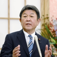 Foreign Minister Toshimitsu Motegi speaks during a news conference at the Foreign Ministry in Tokyo on Wednesday. | KYODO