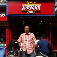 Narendra Gada in front of the spot where his mobile phone shop was once located   | REUTERS